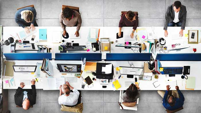 8 People Viewed From Overhead Working In An Office