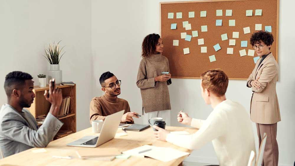 people in meeting making a plan
