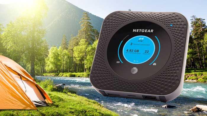 Netgear Nighthawk Router hotspot in nature near tent