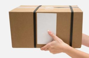 Hands delivering a shipping box