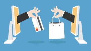 Buy a new smartphone online or in store - 2 hands exchanging card bag from computer