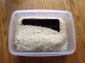 smartphone in rice container