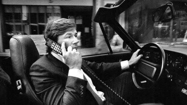 Man Talking on Carphone in Porsche