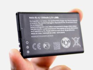 Lithium Ion Battery held between index finger and thumb
