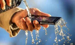 Pouring water over smartphone to clean it