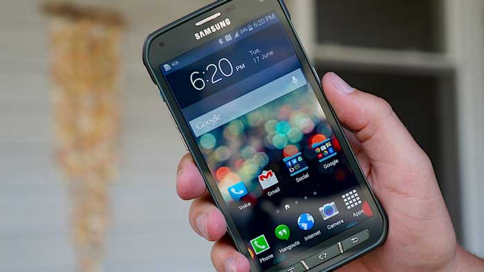 Samsung Galaxy S5 Active Front held in a hand near building