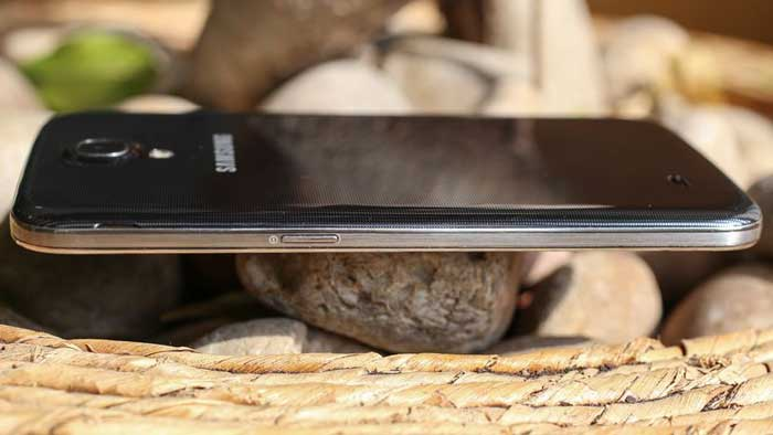 Samsung Galaxy Mega 6.3 laying on its front on rocks and wood
