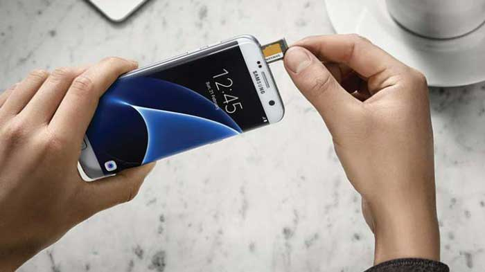 Person holding Samsung Galaxy S7 Removing the SD Card