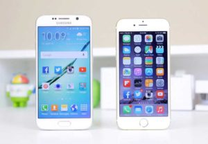 Samsung and iPhone standing on white table