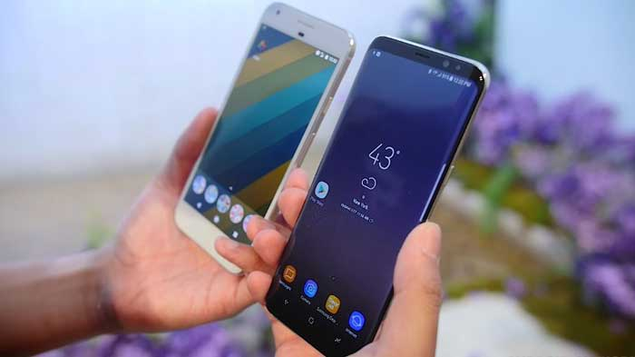 Comparing holding both a Samsung Galaxy S8 and Google Pixel