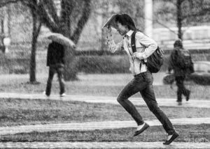 People running for cover from the rain