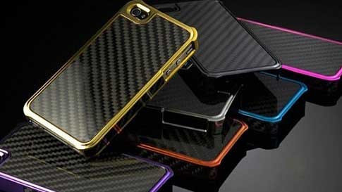 Black background with many smartphones with carbon fiber cases