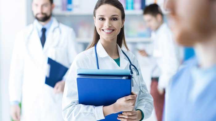 Doctors holding blue binder