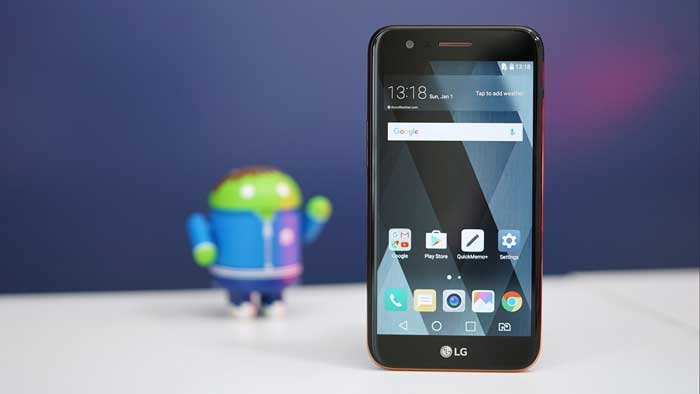 LG K10 standing on table in front of android icon