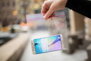 Smartphone in ziploc bag to protect it