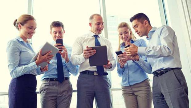 5 business people on their electronic devices