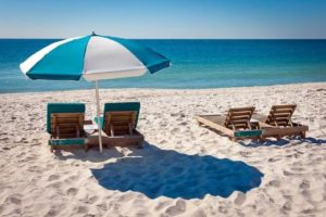 Beach, beach chairs, beach umbrella and water
