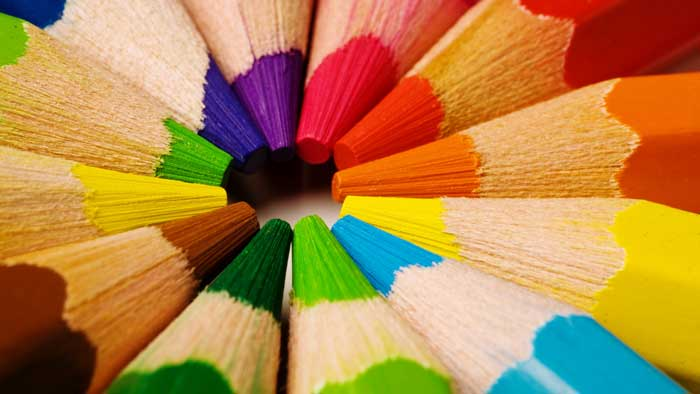 Colored Pencils joining together in the center