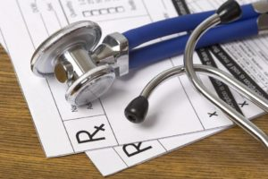 Stethoscope and prescription papers