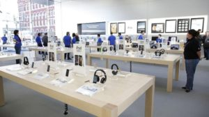 Apple Store filled with Tables and Tech Help