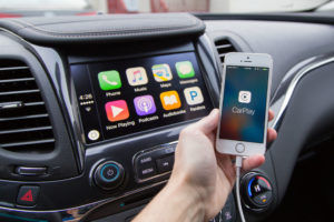Using carplay in car navigation system on smartphone and car