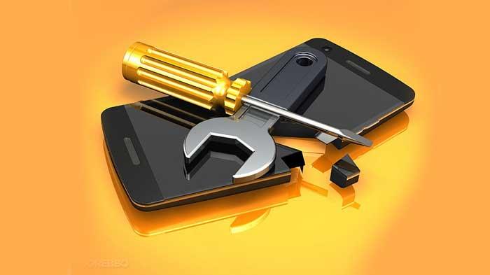 Tools on top of broken smartphone