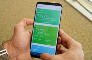 Bixby opened on a device that man is holding