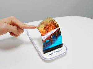 Finger bending a bendable smartphone screen