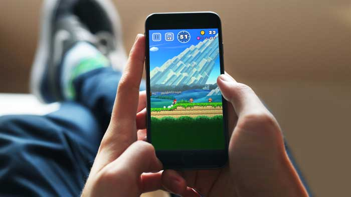 Person playing games with their smartphone