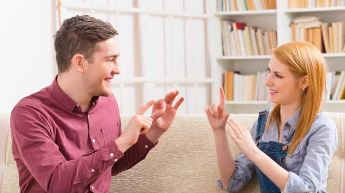 Lady and Man using sign language to communicate