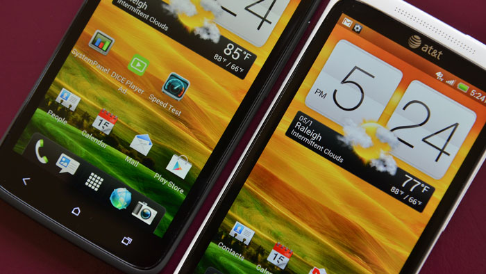 Two HTC One X devices on a red background