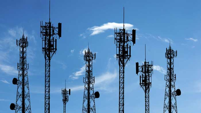 Many cell towers against the blue sky