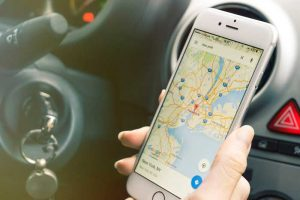Smartphone being used for google maps while driving