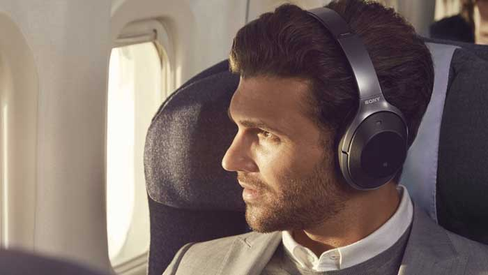 Man wearing Sony WH-1000XM2 Headphones on Airplane