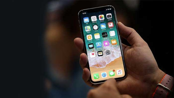 iPhone X held in hand