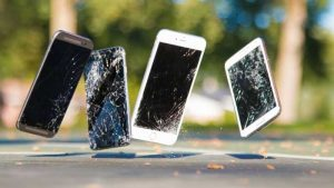 4 smartphones with cracked screen bounding on road