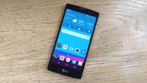 LG G4C laying on wooden table