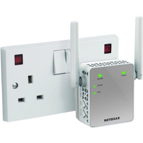 Netgear EX3700 (AC750) plugged into outlet on white background