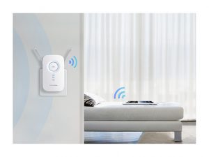 TP-Link RE350 (AC1200) plugged in giving Wi-Fi to device on bed