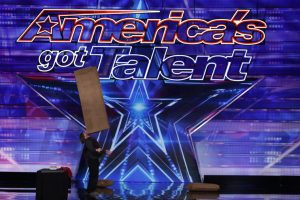 Brian Pankey balancing a box on his nose or mouth at America's got talent