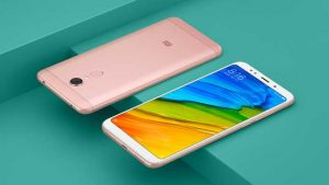 Xiaomi Redmi 5 Plus Smartphone front and back on green