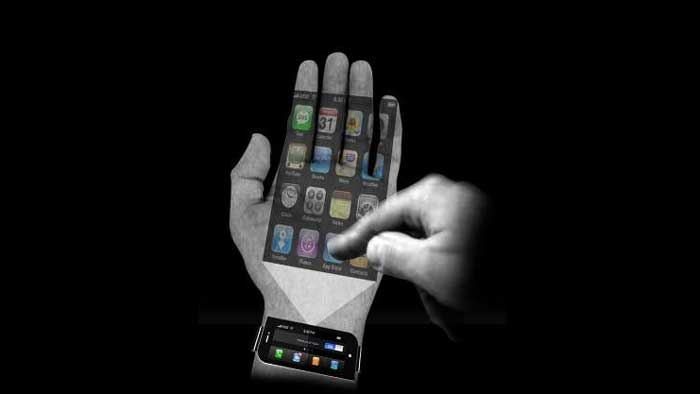 A Holigraphic smartphone being projected on a humans hand