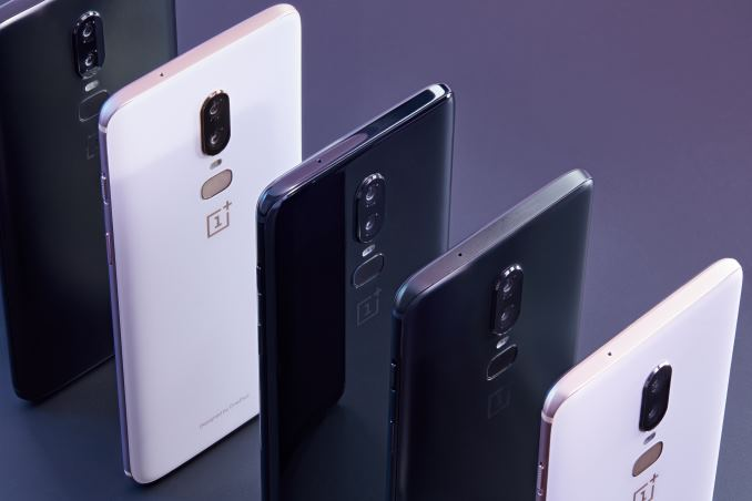 OnePlus 6 four smartphones lined up like dominos