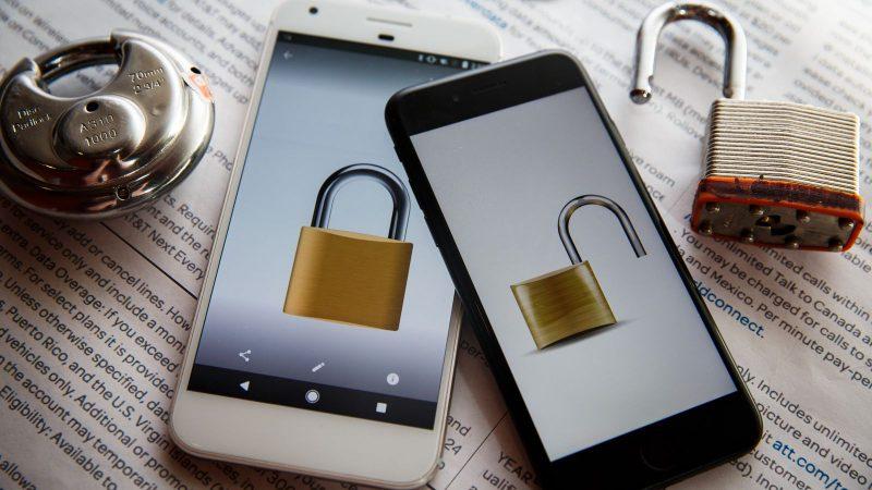Locked vs unlocked phones on newspaper