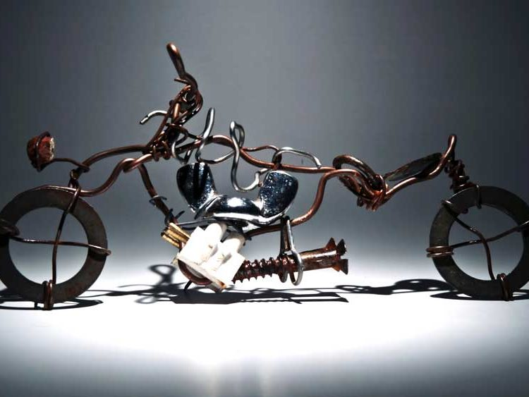 A bicycle built out of recycled metal materials