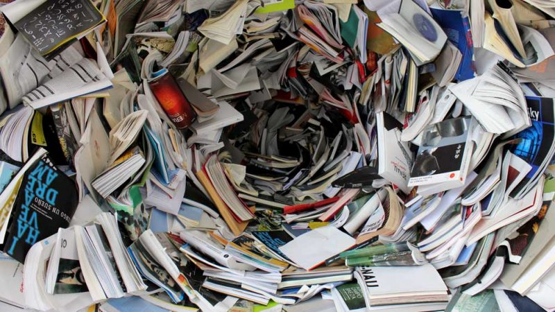 A swirl of books and papers from recycled old items