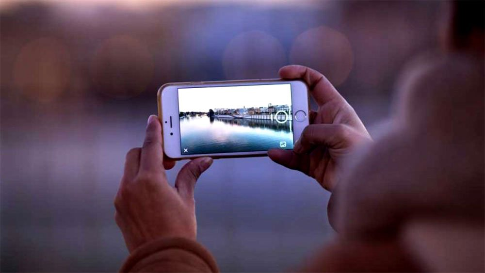 person taking photo with smartphone