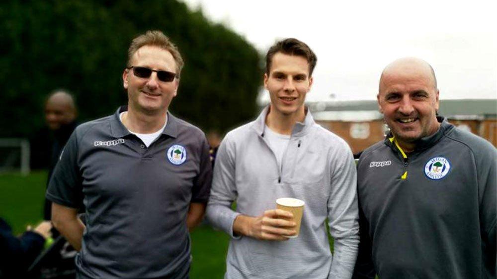 three men on soccer field blurred