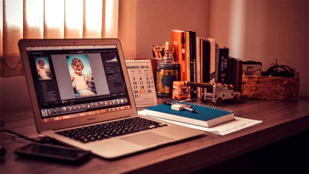smartphone laptop on desk using photoshop