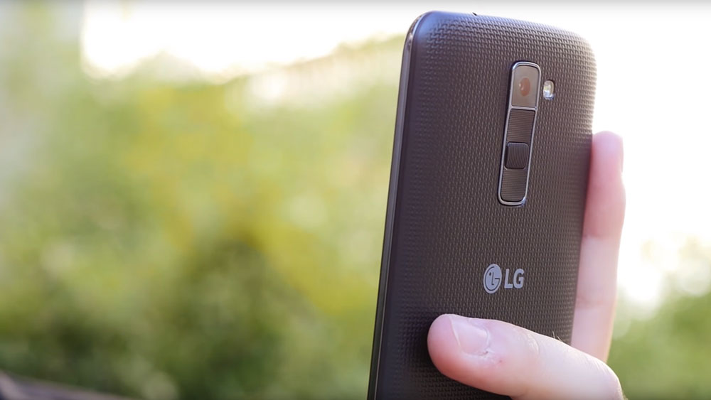 side profile closeup of man holding LG K10